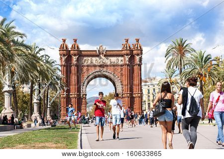 Barcelona, Spain - September 19, 2016: Promenade by Arch De Triumph popular tourist destination with people out walking and enjoying the locale on sunny day
