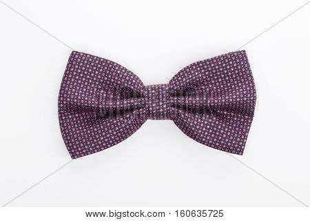 Purplee bow tie isolated on white background