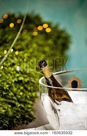 Bottle of champagne in the ice in the restaurant