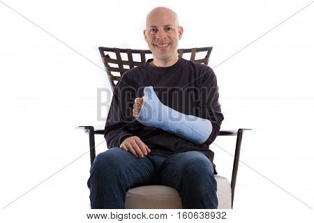 Young Man Making A Thumbs Up Sign With His Casted Arm
