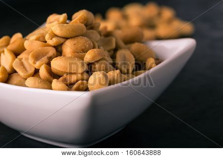White Bowl Full Of Salted Peanuts