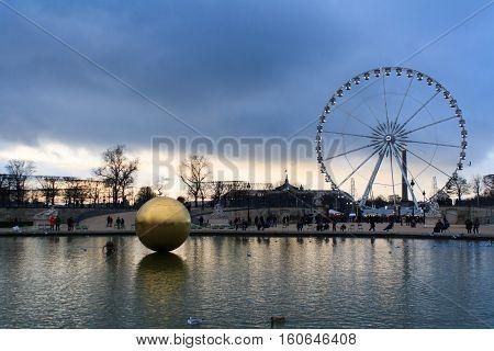 Paris France - January 11 2014: La Grande Roue Ferris wheel and a golden sphere in Paris. Big observation wheel panoramic view