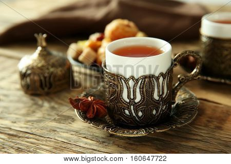 Fresh tea composition on wooden background