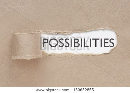 Torn paper uncovered revealing the word possibilities
