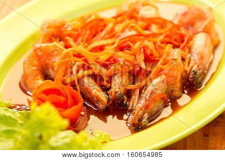 Shrimp prawn in sweet and sour sauce with carrot slices