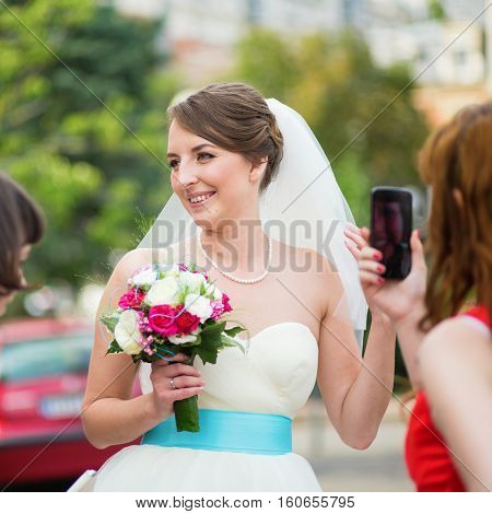 Bridesmaid Is Taking Photo Of A Young Happy Bride