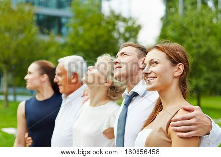 Successful business team standing together outdoors in a row