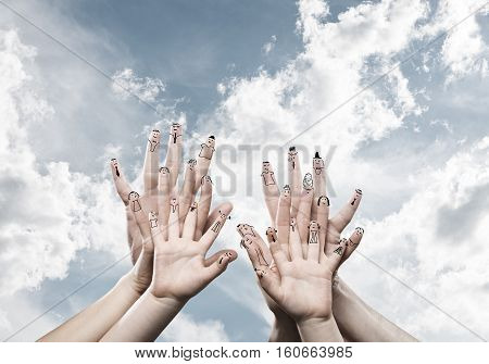 Close view of child and parent hands as symbol of happy family