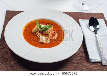 French Bouillabaisse fish soup with seafood, salmon fillet, shrimp, rich taste, tasty dinner