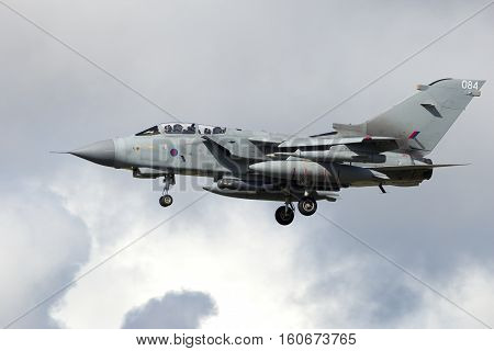 LEEUWARDEN THE NETHERLANDS - APR 8 2016: Royal Air Force Tornado GR4 fighter jet landing during the exercise Frisian Flag. The exercise is considered one of the most important NATO training