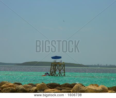 Lone lifeguard tower being staffed vie