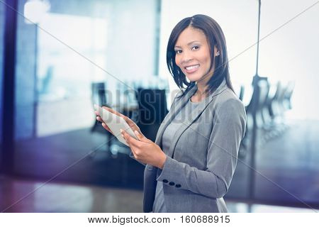 Portrait of attractive businesswoman holding digital tablet