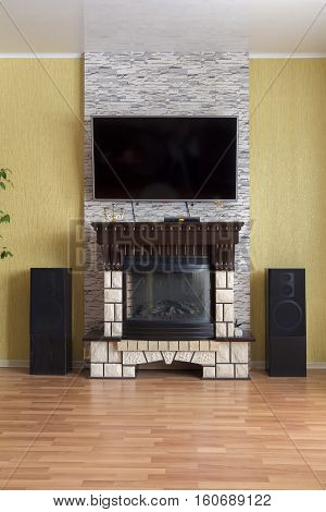 Fireplace TV hi-fi system in the living room of a private modern house.