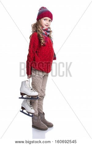 Cute Smiling Little Girl With Curly Hairstyle Wearing Knitted Sweater, Scarf, Hat And Gloves With Sk