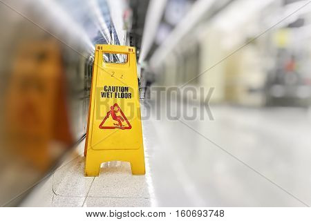 The sign to Beware the wet floor While authorities are clean