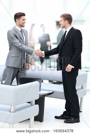Business people shaking hands during a meeting