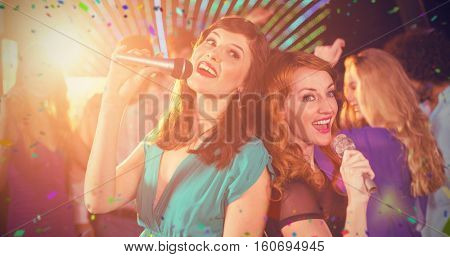 Two beautiful women singing song together against flying colours