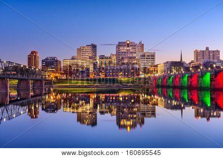 Harrisburg, Pennsylvania, USA skyline on the Susquehanna River with holiday lighting.
