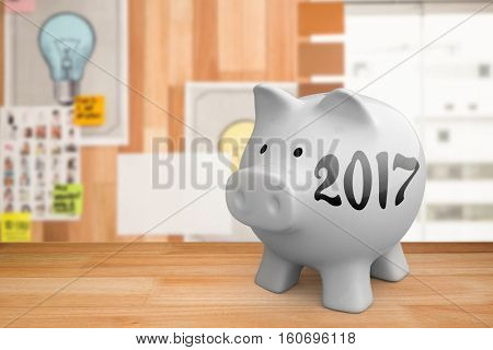 Light bulb charts attached on wooden wall against digital image of new year 2017
