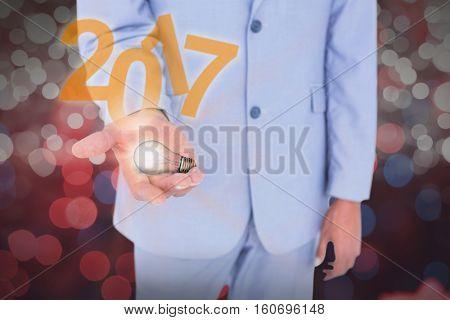 Handsome businessman gesturing with hands against glowing background Handsome businessman gesturing with hands on a white background