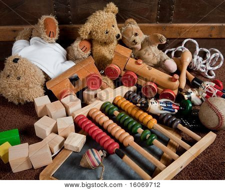 Abandoned old toys against an antique wooden chest