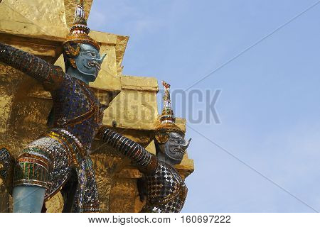 The ramayana giant statues are standing at Wat Ph-ra Kaew Ancient temple in Bangkok, Thailand
