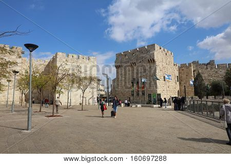 Jerusalem, Israel - November 2 , 2016: People walking through Jaffa Gate outside the old city Wall of Jerusalem. Israel