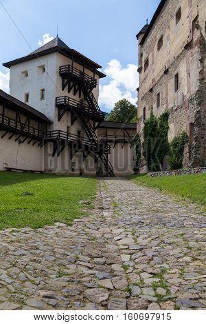 Old medieval castle in Banska Stiavnica Slovakia. Interior courtyard with fortified wall. UNESCO Cultural Heritage.
