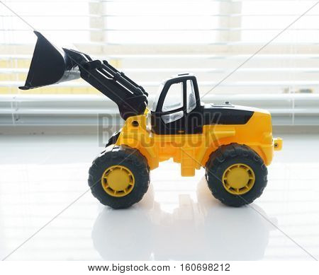 Toy Industrial Vehicle, Plastic Wheel Loader Excavator for Earth Moving Works at Construction Site, Miniature Earth Mover, Backhoe Loader, Frontend Loader with a Big Scoop, Heavy-duty Bulldozer