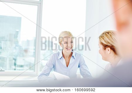 Businesswomen talking about business strategy in office