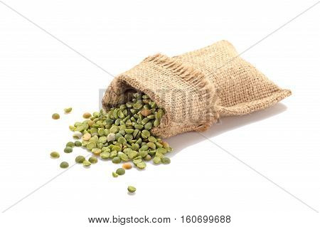 Green peas in a burlap on a white background. Isolated