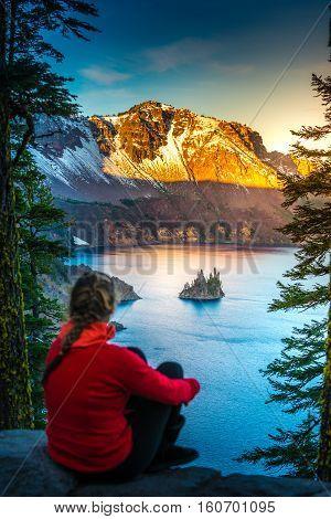 Woman Looking At Phantom Rock Crater Lake Oregon