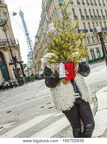 Trendy Child In Paris, France Hiding Behind Christmas Tree