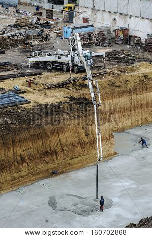 builders build a foundation from cement to a new building
