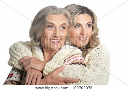 Portrait of two women embracing isolated on white background