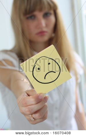 Sad girl with sad smile on note pad