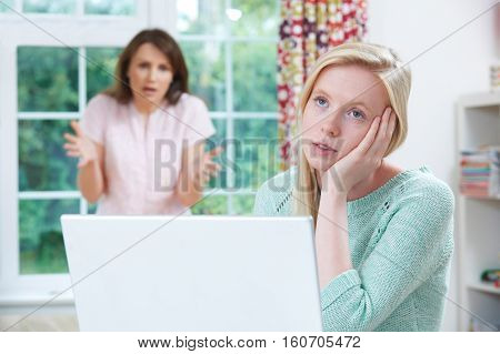 Mother Arguing With Teenage Daughter Over Online Activity