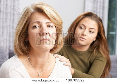 Depressed Mother Being Comforted By Teenage Daughter