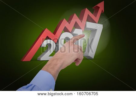 Hand of a businessman pointing something against green background with vignette