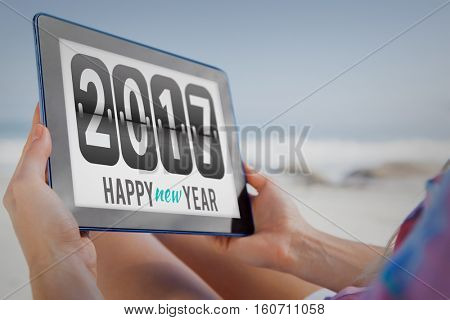 2017 message on tablet at beach