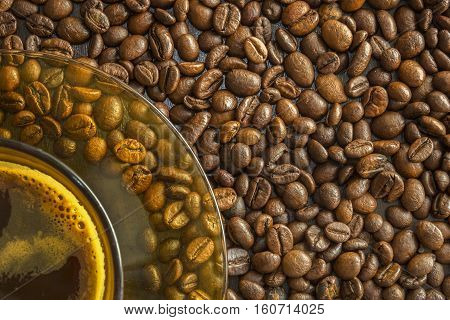 A cup of coffee with beans as background.