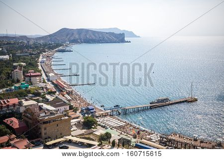 View of black sea and beach from the Genoa fortress in Sudak Crimea in sunny day