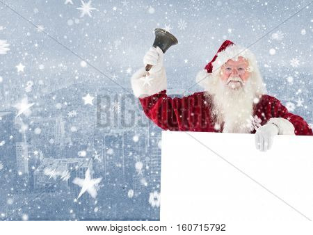 Santa claus holding a blank placard and bell against digitally generated city background