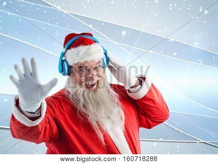 Santa gesturing while listening music on headphones against 3D digitally generated background