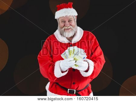 Santa claus holding euro notes against digitally generated background