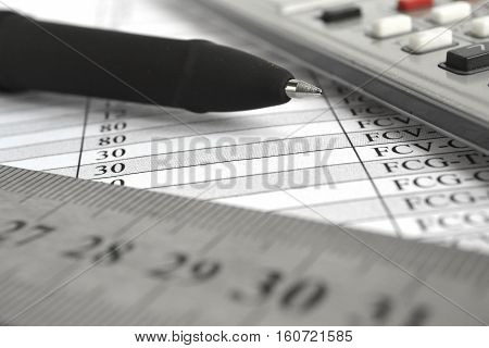 Business background with table ruler pen and calculator.