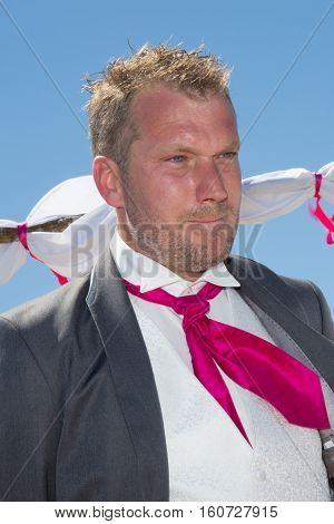 Emotional Man During Wedding Day On Blue Sky