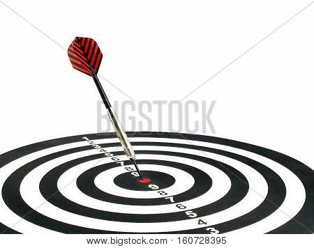 dart arrow hitting in the target center of dartboard isolated on white background, aim goal and achievement