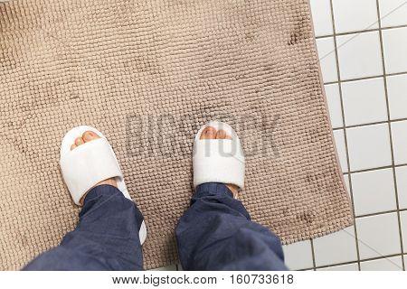 Male Feet In White Slippers, Bathroom