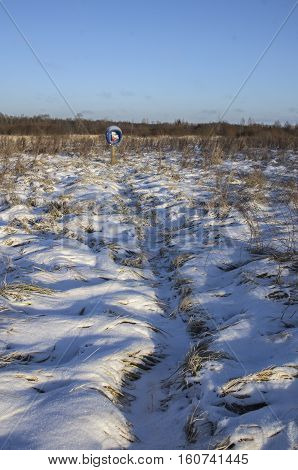 Phone booth in the middle of the snow-covered field (Russia)